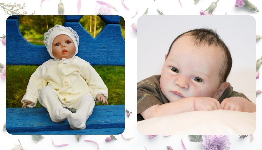 A silicone baby and vinyl baby posing.