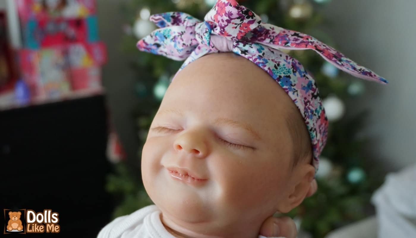Lifelike Baby Doll With Bow