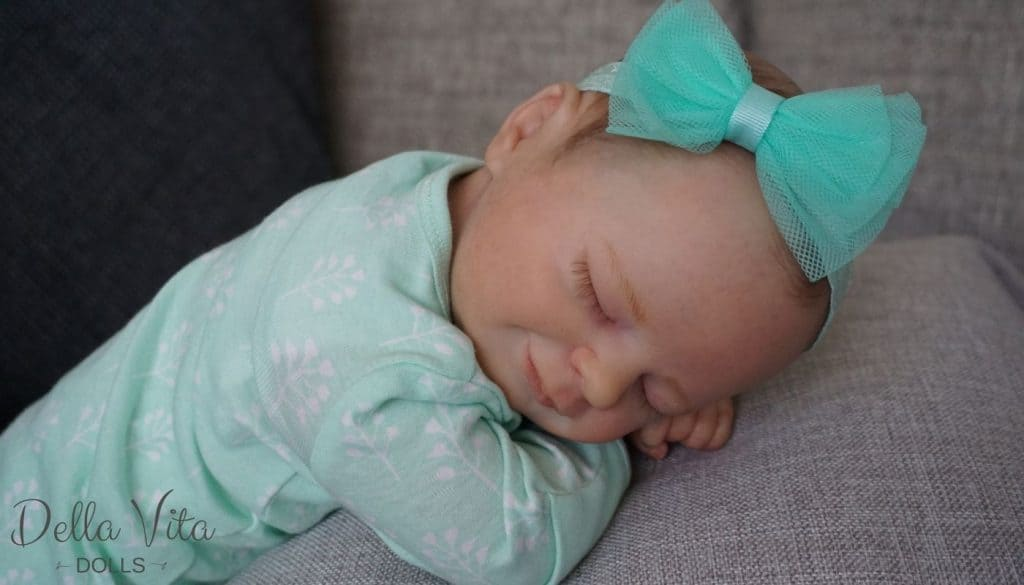 Reborn Baby in Green Clothes With Bow
