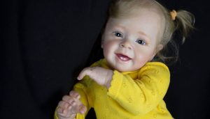 Reborn Doll Smiling with Yellow Shirt