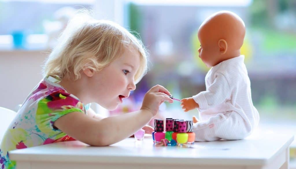 2 Year Old Playing With A Doll