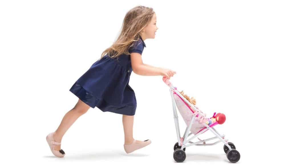 Girl Running With Baby Doll In Stroller
