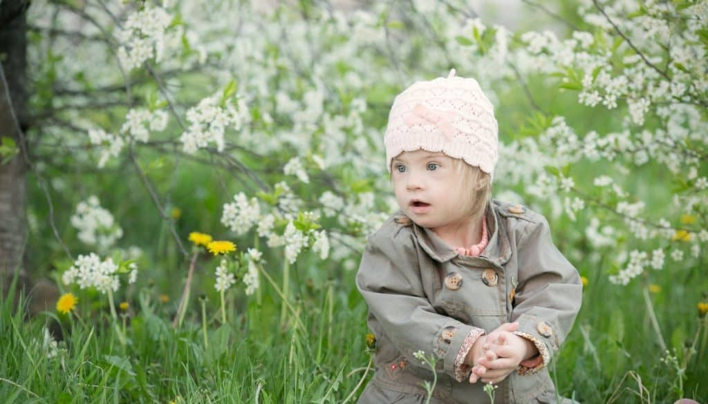 Girl With Down Syndrome By Flowers
