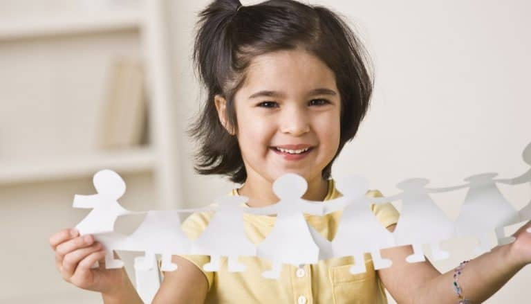 Girl With Paper Doll Cutouts